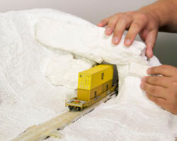 Diorama Part 11: Adding Rocks and Smoothing the Surface for Your Model Railroad